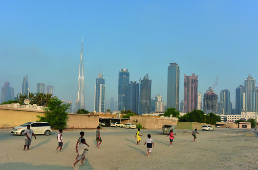 Children playing soccer on sandy street outside the boundaries of bigness. Image Courtesy of National Pavilion UAE - la Biennale di Venezia