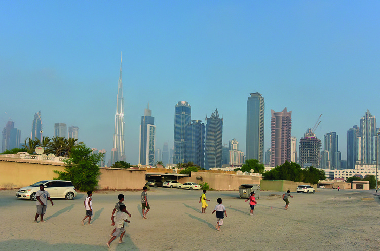 UAE Pavilion at the 2018 Venice Biennale to Explore Human-scale Landscapes and Social Spaces, Children playing soccer on sandy street outside the boundaries of bigness. Image Courtesy of National Pavilion UAE - la Biennale di Venezia