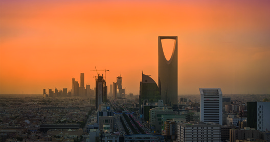 Riyadh Skyline. Image © <a href='https://commons.wikimedia.org/wiki/File:Riyadh_Skyline_showing_the_King_Abdullah_Financial_District_(KAFD)_and_the_famous_Kingdom_Tower_.jpg'>Wikimedia user B.alotaby </a> licensed under <a href='https://creativecommons.org/licenses/by-sa/4.0/deed.en'> CC BY-SA 4.0</a>