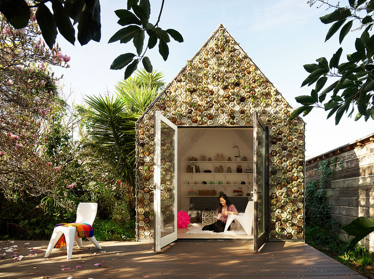 Backyard Cabin Experiments With 3D-Printed Tiles as a Facade Material, The cabin is integrated into the landscape thanks to the hundreds of succulents and air plants that comprise the facade and are held by the 3D-printed hexagonal planter tiles. 3D-printed chairs and tables, also designed by Emerging Objects, serve as both indoor and outdoor furniture. Image © Matthew Millman
