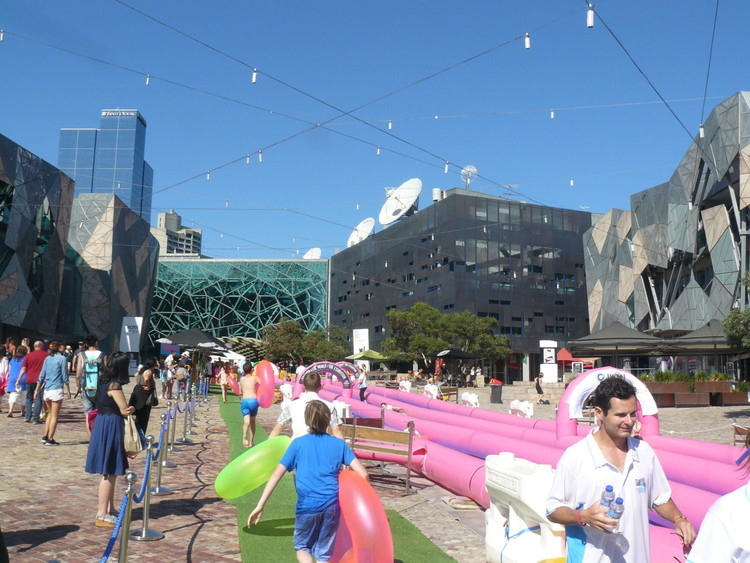 A waterslide setup in Federation Square, Melbourne, Australia. Image © Ben Willis