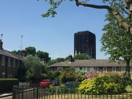 The burned remains of Grenfell Tower in London. Image © <a href='https://www.flickr.com/photos/londonmatt/35651730645'>Flickr user londonmatt</a> licensed under <a href='https://creativecommons.org/licenses/by/2.0/'>CC BY 2.0</a>