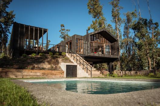 Casa Rapel / Bauer Arquitectos