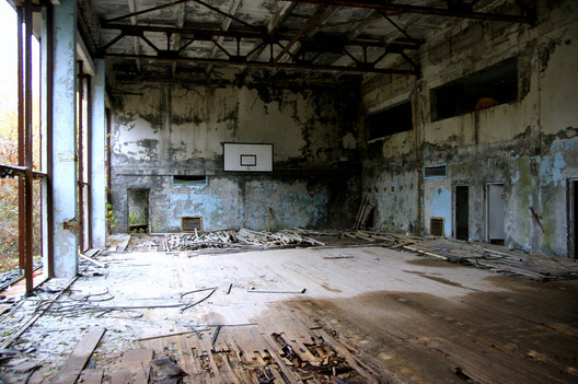 "Abandoned school, Pripyat. Image © <a href='https://www.flickr.com/photos/donmaedi/26461204149/in/photolist-GjhA6K-9qYTYA-4xkQpJ-9qW5Yr-9r3efV-21aShpw-b5kdJM-b5kCW6-9zB4Rv-JoyxWg-nMrm1v-Jow2Fm-9r3g9z-g9rGUb-22yPnEA-9CgDYX-9qVSwk-UAm1fJ-9qZd4W-9qVMKH-FH96jR-VEKZTm-UJc4gn-25kKcP7-5dMBgF-Higje3-nJa79q-9qVSJ8-9qW8tx-229e1cb-48F4cW-hx5E4P-nLGrph-9qYBad-23VXw32-9qVZW2-VU1fxr-VGwNBV-QLmePi-9r3frR-g9rTVQ-22CdtMb-5dLVbV-GjB4AP-25cfT1j-VhBQUd-nDm5RN-D8w6WQ-g9sasT-atno21'>Flickr user donmaedi</a></noindex></noindex> licensed under <ahref='https://creativecommons.org/licenses/by-nd/2.0/'>CC BY-ND 2.0</a>"" title=""Abandoned school, Pripyat. Image © <noindex><noindex><a target="