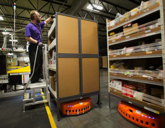 Robotic motorized shelving in use at Amazon warehouse . Image Courtesy of Stanislas Chaillou