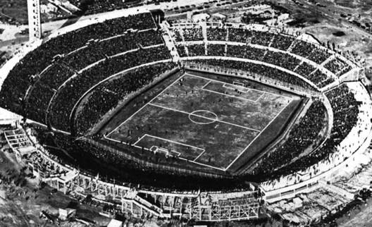 Image by Archivo de El País <a href='https://commons.wikimedia.org/wiki/File:Estadio_Centenario_1930.jpg'>via Wikimedia</a> (public domain)