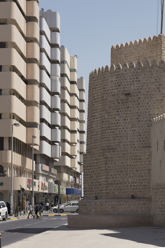 Street view of Bank Street buildings and Al Hisn Fort Museum, Sharjah. Image © Paul Gorra