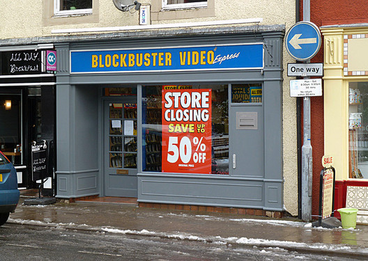 Closing down sale at Blockbuster Video, Bank Street, Galashiels. Image © <a href='https://www.geograph.org.uk/profile/6638'>Walter Baxter</a> licensed under <a href='https://creativecommons.org/licenses/by-sa/2.0/'>CC BY-SA 2.0</a>