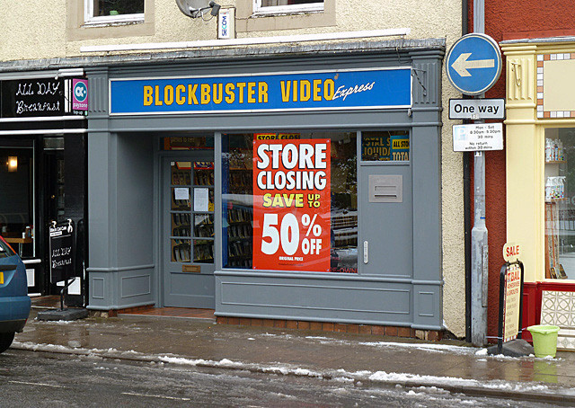 6 Modern Building Types That Will Soon Disappear Forever, Closing down sale at Blockbuster Video, Bank Street, Galashiels. Image © <a href='https://www.geograph.org.uk/profile/6638'>Walter Baxter</a> licensed under <a href='https://creativecommons.org/licenses/by-sa/2.0/'>CC BY-SA 2.0</a>
