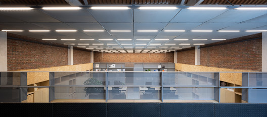 front view of office space at ground level (artificial lighting). Image © Hao Chen