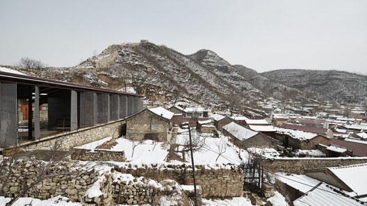 New building overlooking the village. Image © Lei Jin