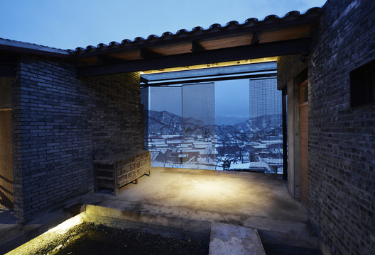 the courtyard link to the village. Image © Lei Jin