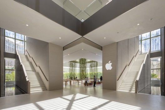 Apple Store, Sands Cotai Central, Macau - interior at retail level with stone stairs descending from the cube. Image Courtesy of Nigel Young, Foster + Partners