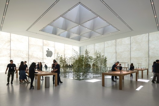 Apple Store, Sands Cotai Central, Macau - retail floor inside the cube lantern with bamboo rising from the planters below. Image Courtesy of Nigel Young, Foster + Partners