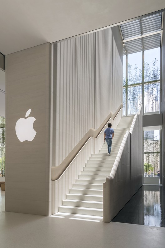Apple Store, Sands Cotai Central, Macau - stone staircase ascending with Apple logo. Image Courtesy of Nigel Young, Foster + Partners