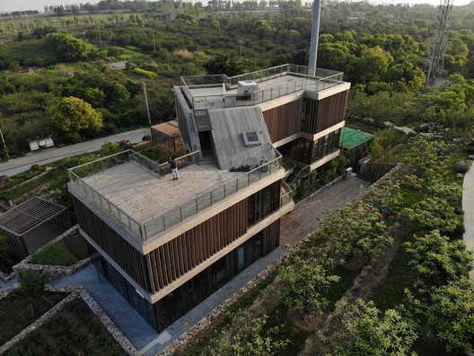 North side aerial view. Image © Yue Shen