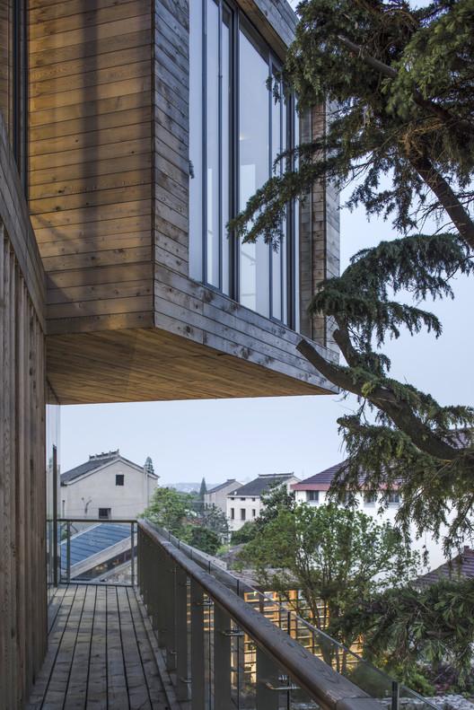 Second floor balcony overlooking the village. Image © Kun Zhang