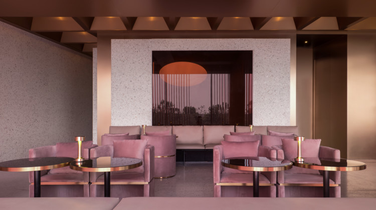 Wann lounge / Various Associates, The Lights in Cigar room hide behind red glasses shown as sunrise.. Image © Chao Zhang