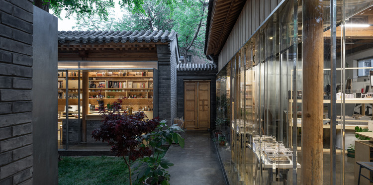 Dwelling in Hutong / MINOR lab, view from courtyard to entrance (with artificial light). Image © Hao Chen