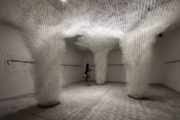 """Forget """"Post-Digital"""": Why Technological Innovation in Architecture is Only Just Getting Started, Cloud Pergola, the Croatian National Pavilion at this year's Venice Architecture Biennale, is one of the largest robotically extruded 3D-printed structures ever built. The robotic arm was trained to adapt to the unpredictable material behavior, by gleaning real-time feedback from the construction process. The installation was designed by Alisa Andrasek (with Bruno Juricic and Madalin Gheorghe), engineered by Arup London, and fabricated by Ai Build. Image © Luke Hayes"""