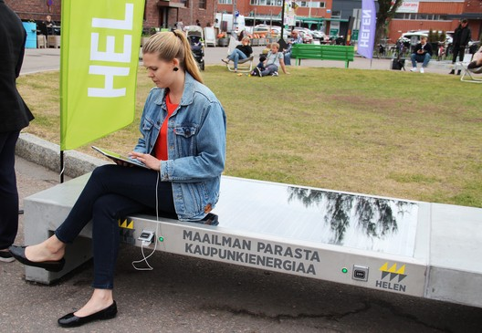 One of five Ecotap Solar Benches installed in Helsinki by Helen. The bench, which stores solar power, can be used to charge mobile devices and electric bicycles. The benches are part of the mySMARTLife EU project to cut urban carbon dioxide emissions. Photo attribution: Helmi Carpén / Helen
