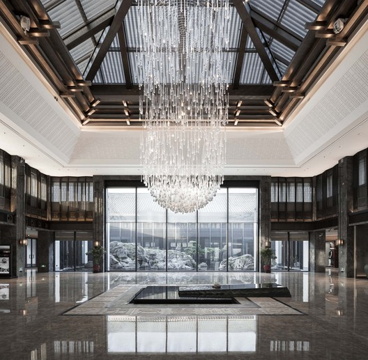 """Entering the lobby, you can feel natural light through the glass ceiling. The modern-style architectural structure expresses the spirits of place """"skylight"""" and """"yard"""" in the traditional architectural culture of Shaoxing. Image © Qiang Zhao"""