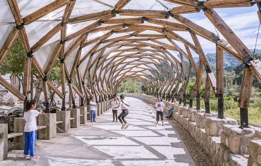 Kids skipping ropes under the pergola. Image © Weiqi Jin