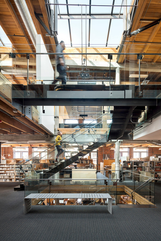 Olson Kundig's Innovative Office Renovation and Expansion, Olson Kundig's Pioneer Building office blends historical detailing with modern accents. Image © Andrew Pogue via Metropolis Magazine