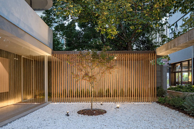 Wooden grille veranda looking out. Image © Fangfang Tian