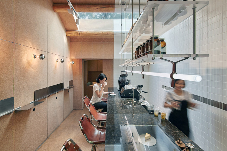 Big Small Coffee + B&B / Office AIO. Image © Yu Cheng
