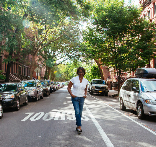 Planner and educator Toni Griffin walks down her block in Harlem. Image © Naima Green