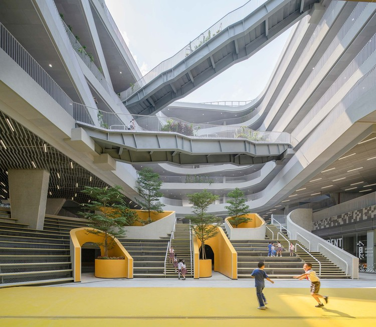 Hongling Experimental Primary School / O-office Architects, The north Valley courtyard with open-air theater on the bottom. Image © Chao Zhang
