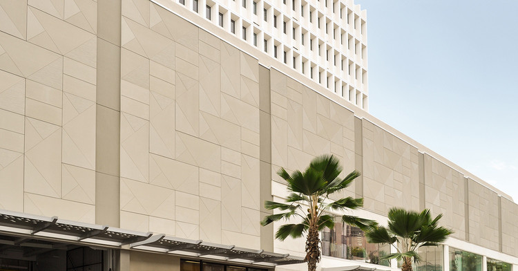 TAKTL's ultra-high-performance concrete panels on the Waikiki Business Plaza by MGA Architecture. Image © TAKTL