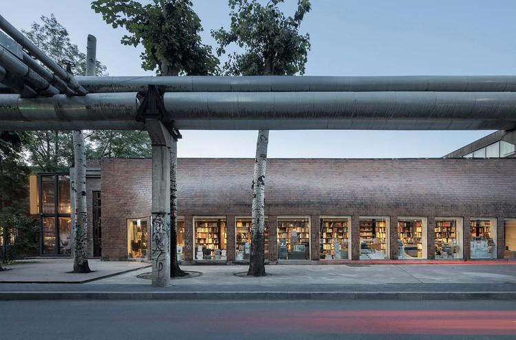 Bookstore in 798 Art Zone / 3andwich Design / He Wei Studio, south facade night view. Image © Liming Fang