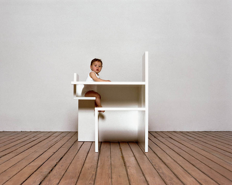 """Politics Has Failed Mothers. Can Design Help?, With her Mother/Child Dining Table, Maartje Steenkamp reflects on the connection between parents and their babies at mealtime. """"[It] goes much deeper than just giving food; mother and child are almost one, as with the umbilical cord before birth,"""" she says. """"In this way the furniture has to be one, too."""" She based the orientation of its seats, and the length of the table, on the size and position of her own body while feeding her child. Courtesy Inga Powilleit"""