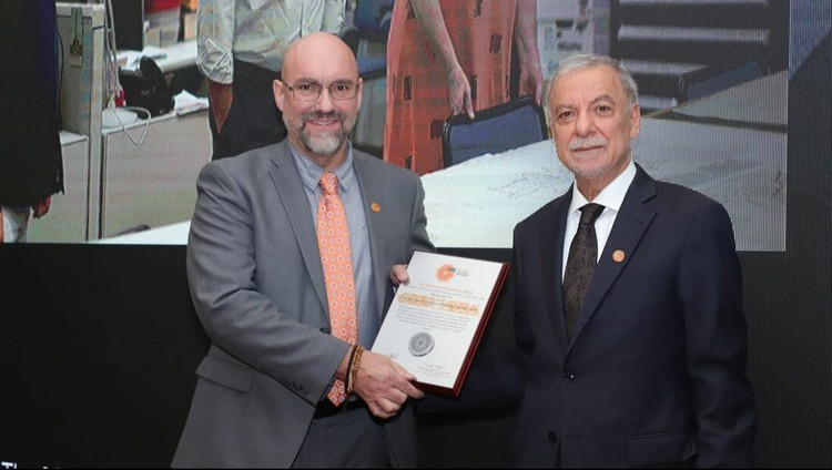 The Middle Eastern Architectural Personality of the Year | Mohamed Makiya Prize | Tamayouz Excellence Award 2020, Dr Michael Toler receiveing the prize on behlaf of the Aga Khan Documentation Center @ MIT at the 2018 Tamayouz Excellence Award's Annual Ceremony.