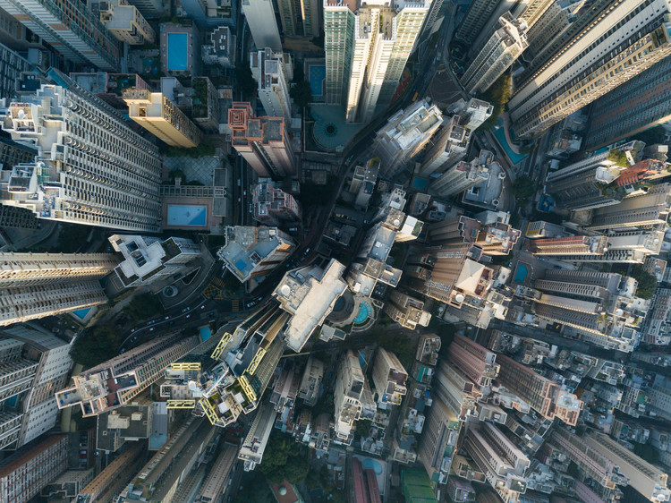 City Top View of Skyscrapers Building by drone Hong Kong city. Image © Shutterstock/ By Bigone