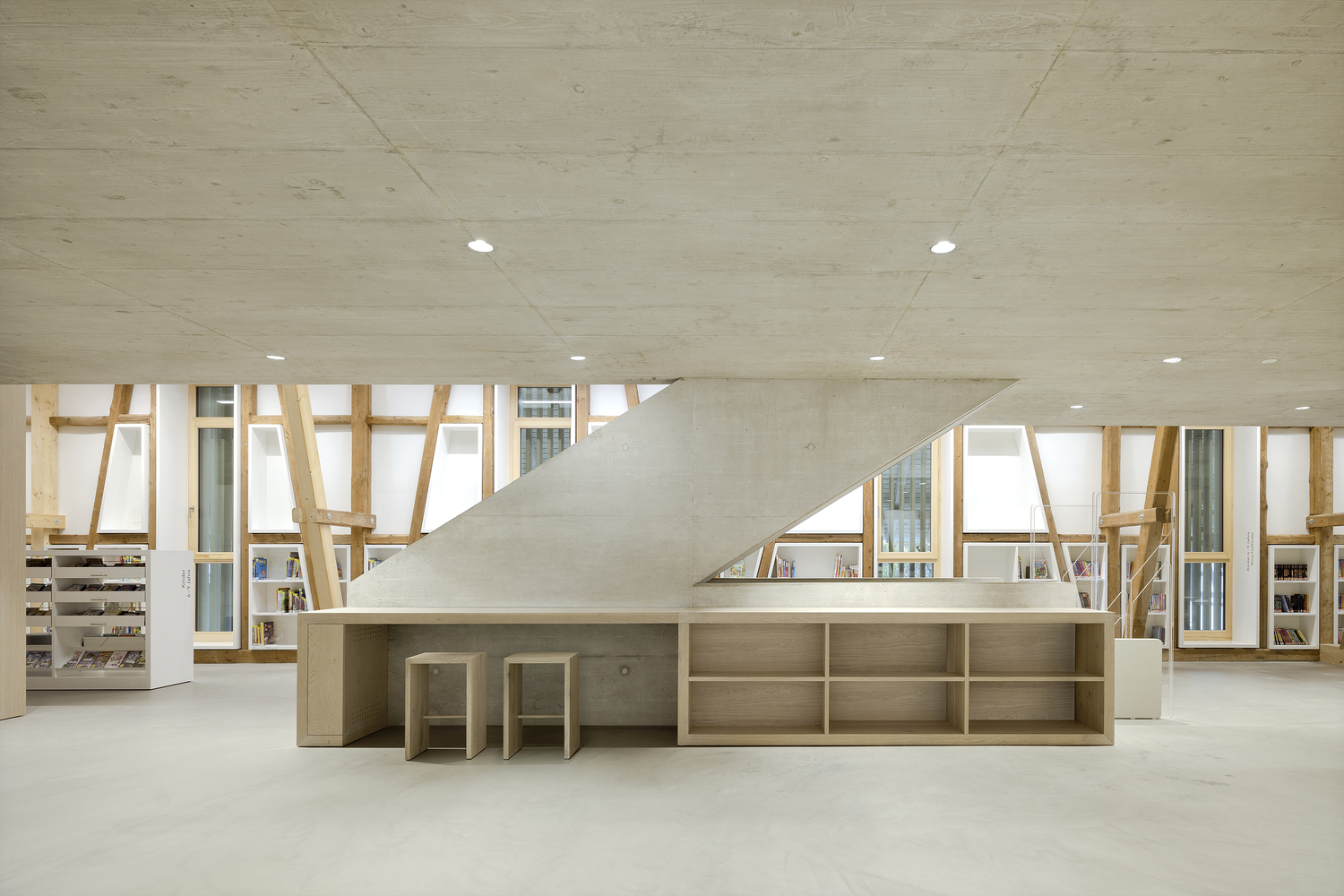 Raw Interiors: 20 Projects that Use Exposed Wood and Concrete
