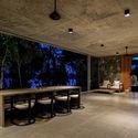 03.2   Living and Dining spaces looking over Madu River - Pia's Villa / MMGS ARCHITECTS: Biệt thự hiện đại trên đồi với không gian thoáng tự nhiên