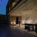 04  View of the Living  Dining from the Garden by night - Pia's Villa / MMGS ARCHITECTS: Biệt thự hiện đại trên đồi với không gian thoáng tự nhiên