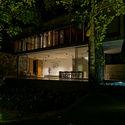 04.1  View of the Living  Dining from the Garden by night - Pia's Villa / MMGS ARCHITECTS: Biệt thự hiện đại trên đồi với không gian thoáng tự nhiên