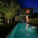 05a   View of the Villa from the poolside by night - Pia's Villa / MMGS ARCHITECTS: Biệt thự hiện đại trên đồi với không gian thoáng tự nhiên