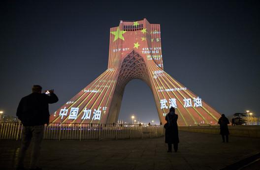 Azadi Tower in Tehran, Iran, illuminated to support China combating Covid-19. Image: © Ahmad Halabisaz