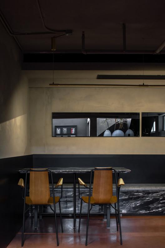 Restaurant on the basement floor. Image © Chuan He