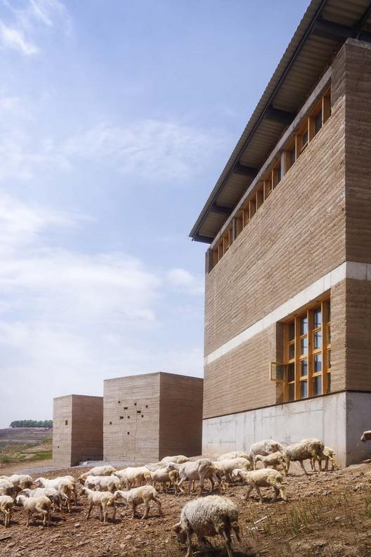 Macha Village Center / Oneartharch architect