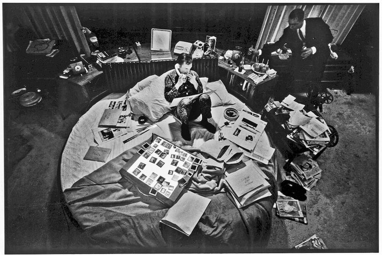 The Homescape; the New Commute, Hugh Hefner in bed at work with array of stimulants at the Playboy Mansion in Chicago. Copyright: Playboy Enterprises International, Inc.