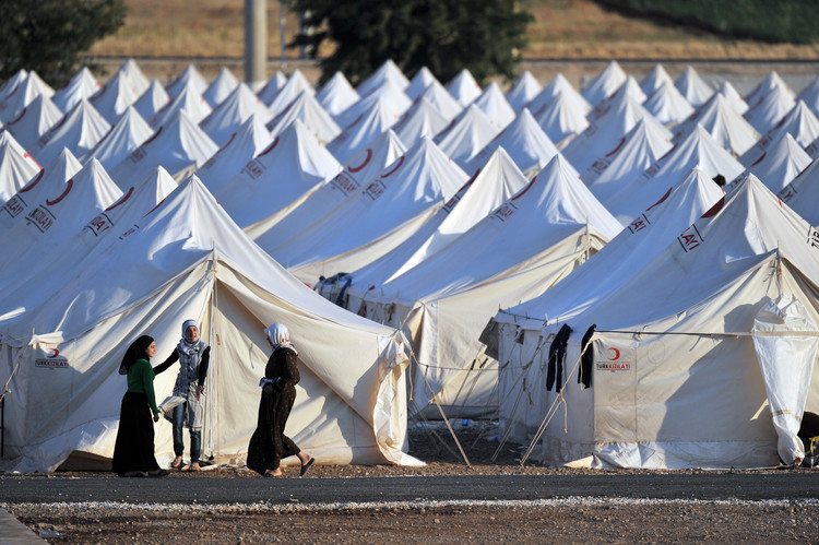 Refugee Camps: From Temporary Settlements to Permanent Dwellings, Syrian refugee camp in Turkey . Image via Shutterstock/ by Thomas Koch