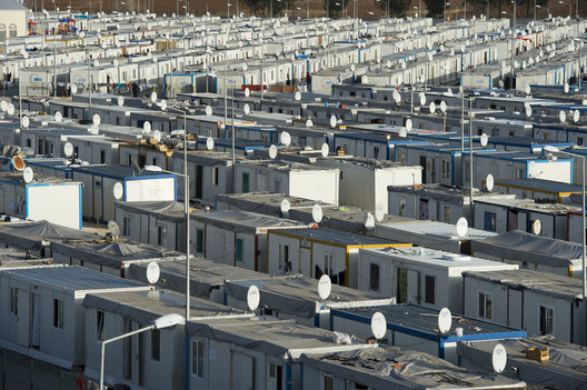 SANLIURFA, TURKEY - February 19, 2014: Aerial view of Akcakale Refugee Camp. Approximately 28.000 Syrian people reside in Akcakale Tent Camp in Urfa.. Image via Shutterstock/ By answer5