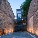 The historic exterior walls of the original building well-preserved with new traffic construction added. Image © Yilong Zhao