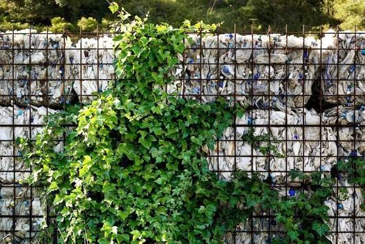 Gabion wall filled with plastic bottles. Image © Jordi Surroca